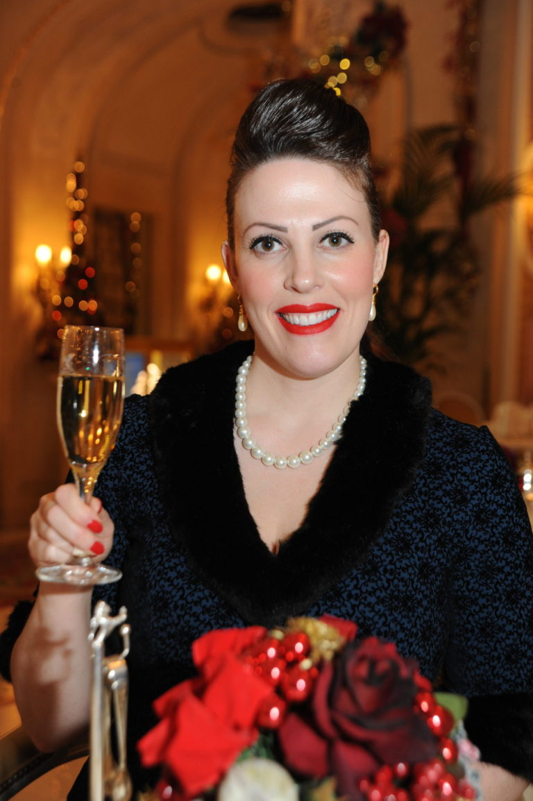 Miss Windsor's Delectables - Christmas Afternoon Tea at The Ritz, London. A glass of Reserve Ritz Champagne Barons De Rothschild. Vintage dress by Collectif.